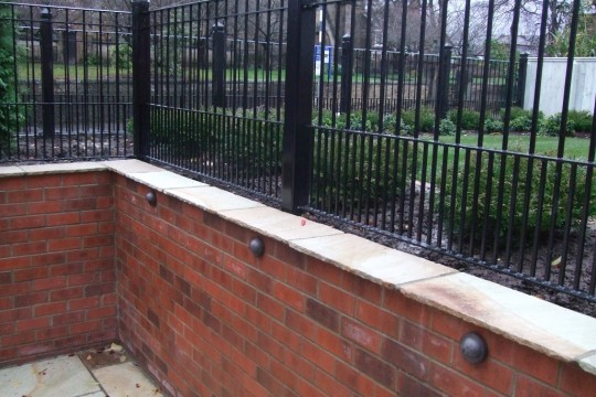 brick-wall-and-metal-fence