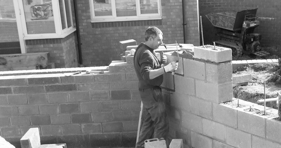 man-constructing-garden-wall