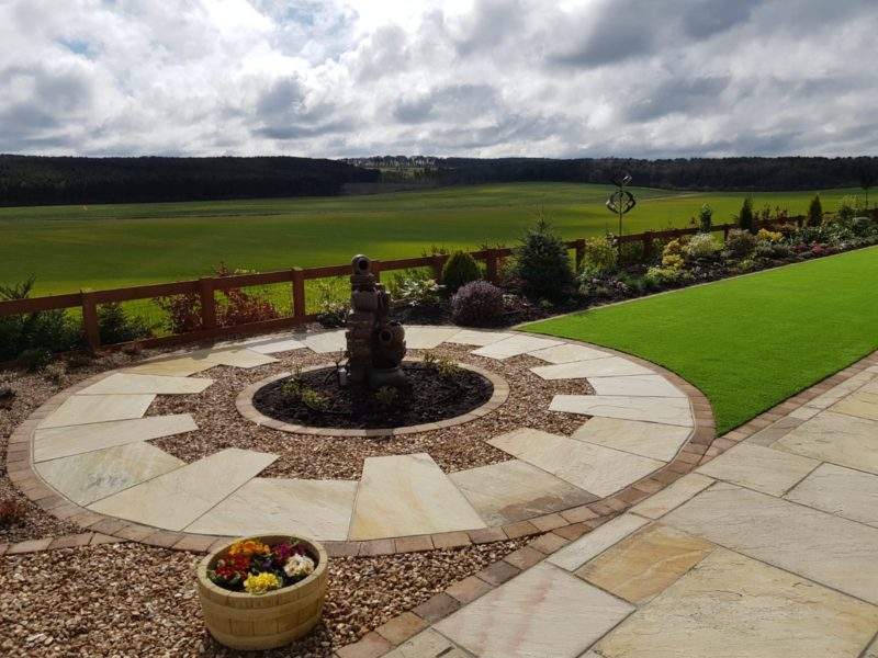 artificial grass and centrepiece fountain