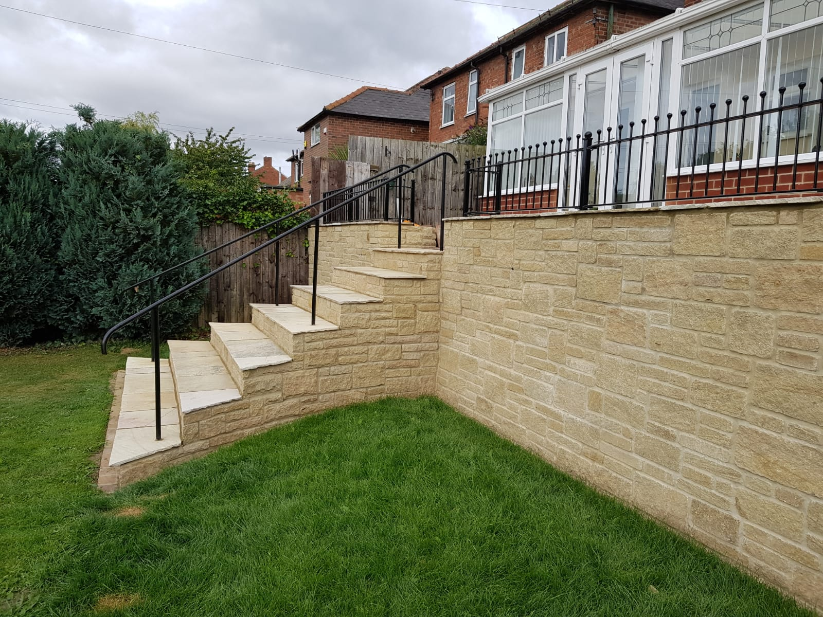side view of finished steps and retaining wall