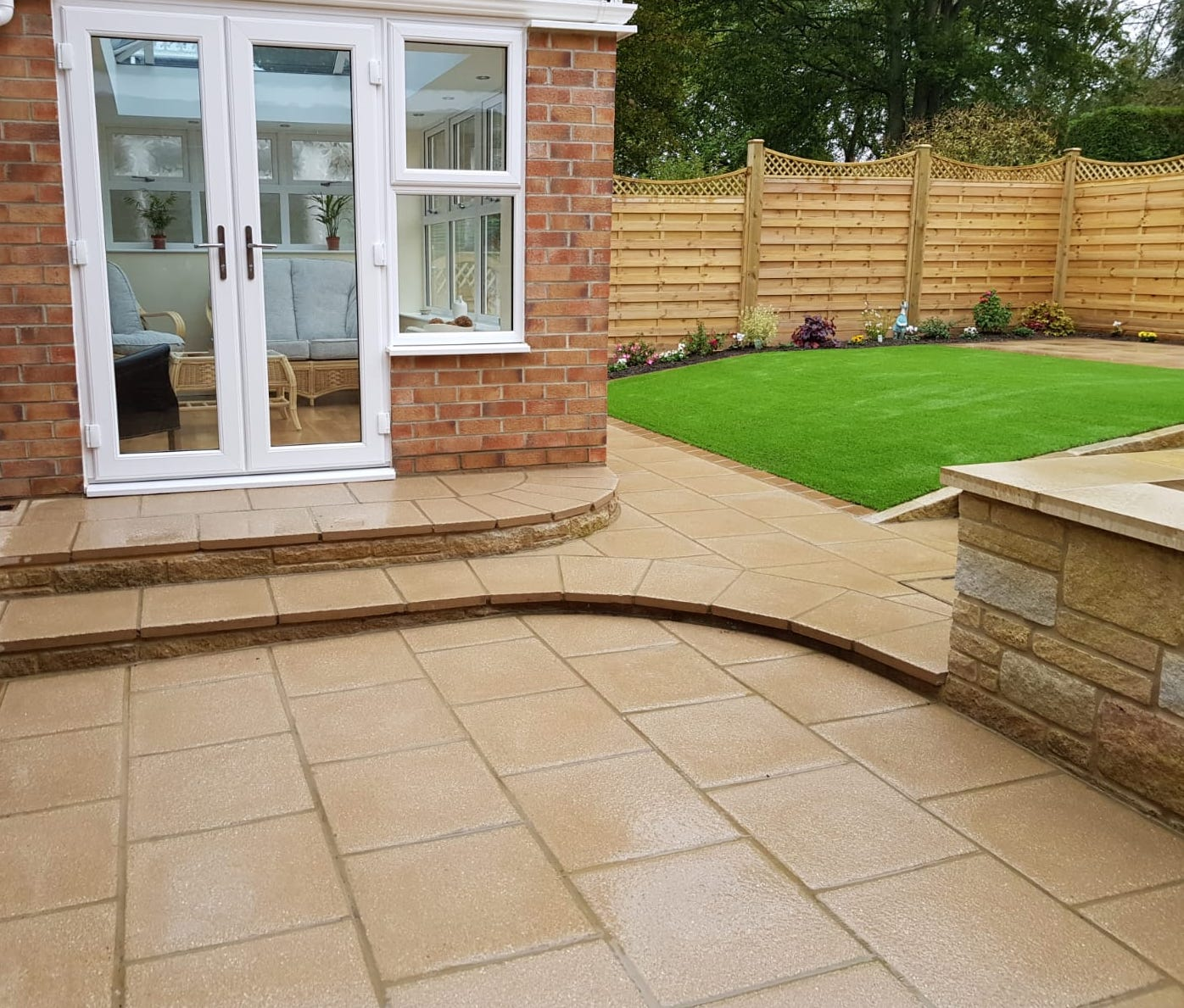 Textured paved path with conservatory