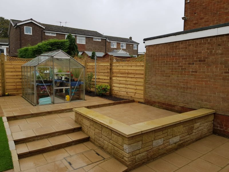 patio area with textured paving slabs