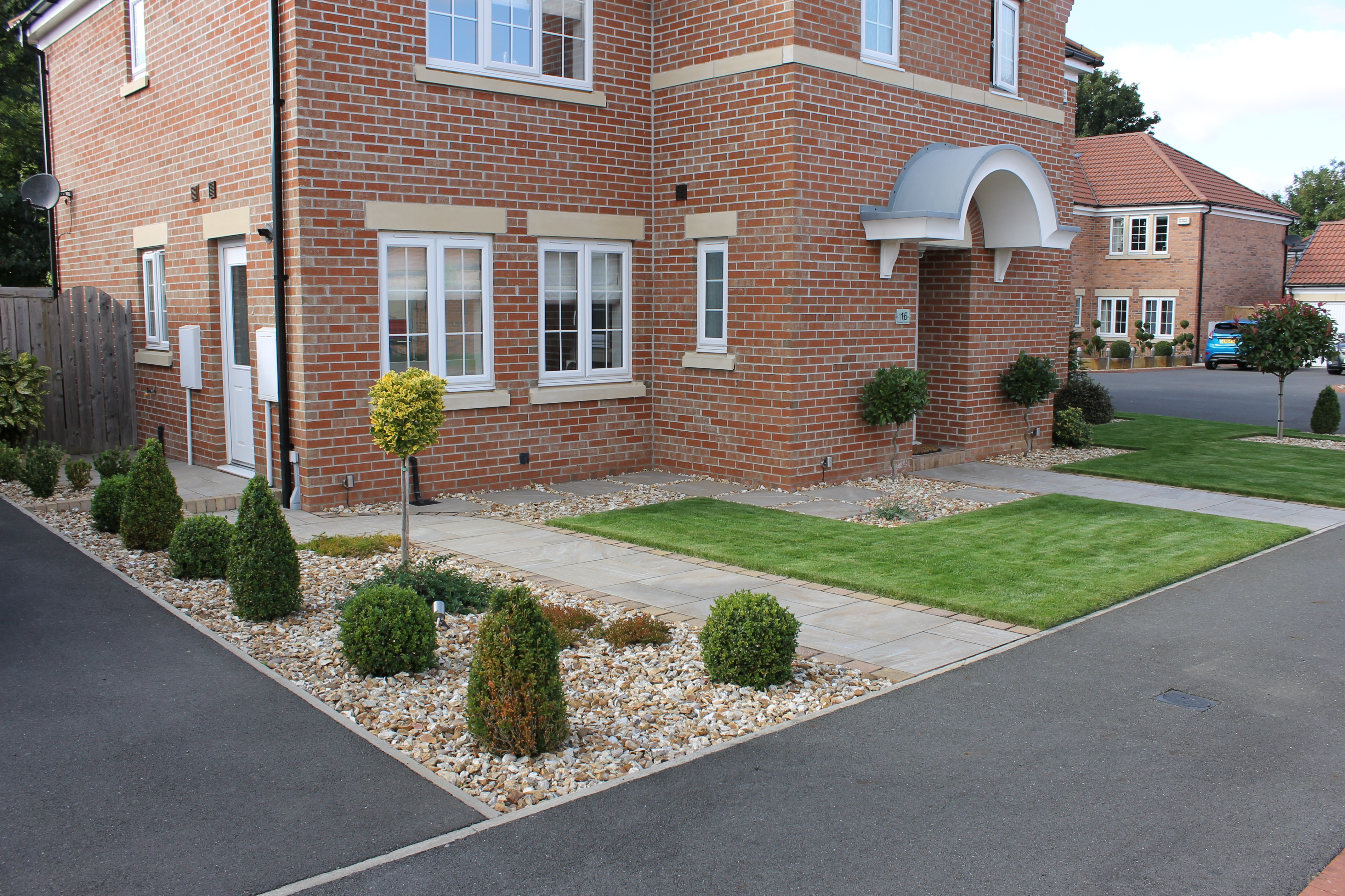 front garden design with driveway and shrubbery