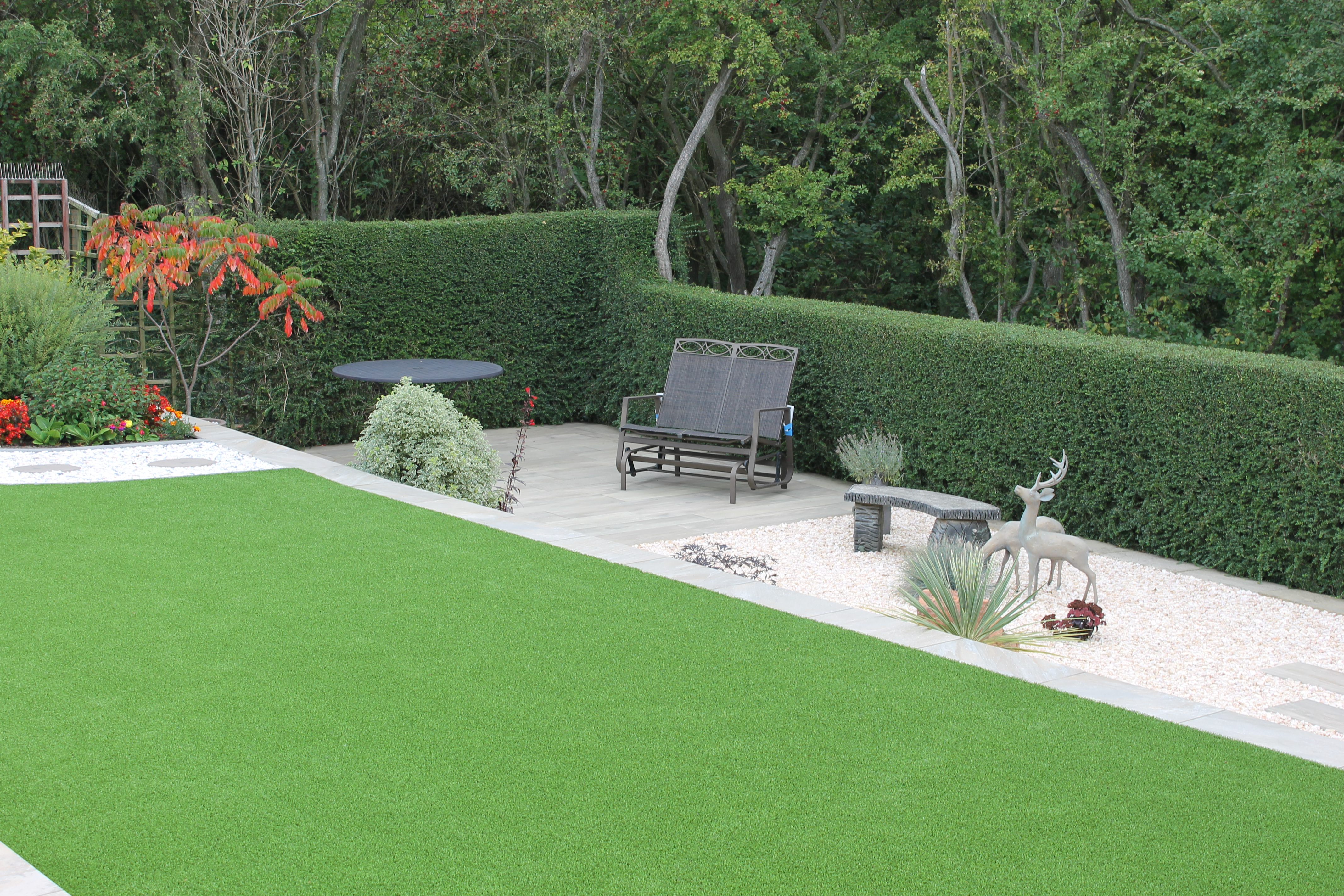 artificial grass, paving and seating area