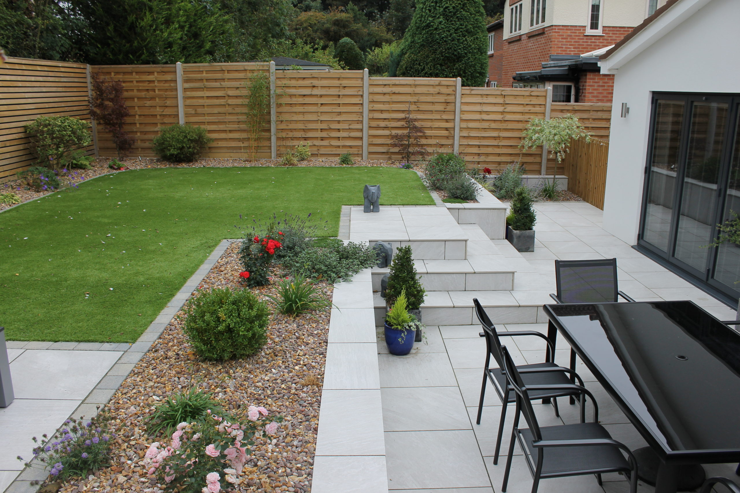 Raised garden with white porcelain steps